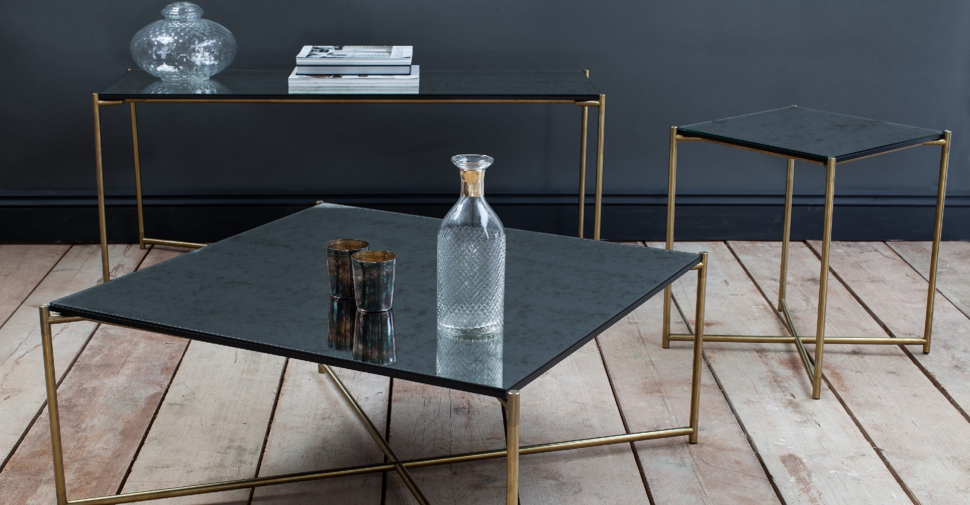Iris Antique Glass tables And Brushed Brass Tables by Gillmore © GillmoreSPACE Ltd