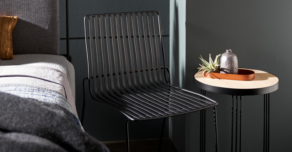 Finn Black Dining Chair And Light Wood Side Table Detail © GillmoreSPACE Ltd