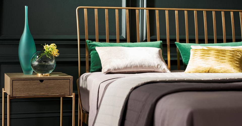Finn Brass Bed Headboard Detail With Iris Side Table by Gillmore © GillmoreSPACE Ltd